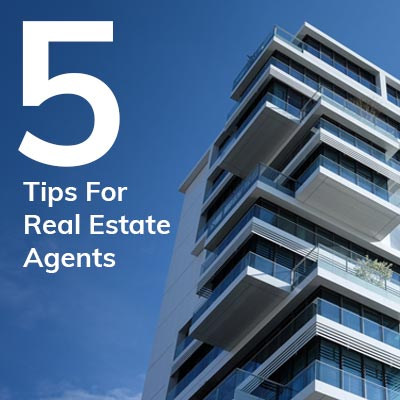 5 Tips For Real Estate Agents. Modern residential building and blue sky.