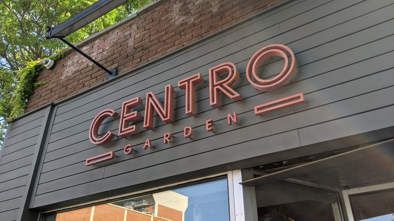 Centro Gardens CNC cut sign over top of their window and entrance on Brant St.