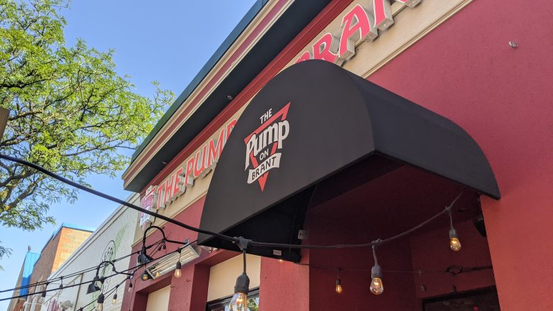 The Pump on Brant awning with their logo printed on it.