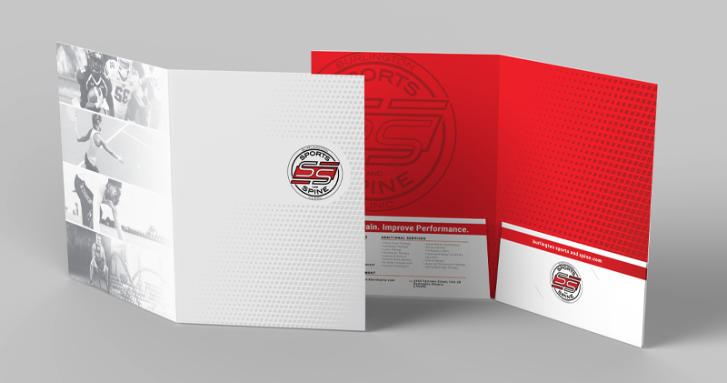 Pocket folder folded up, showing front and back, branded to a chiropractic clinic.